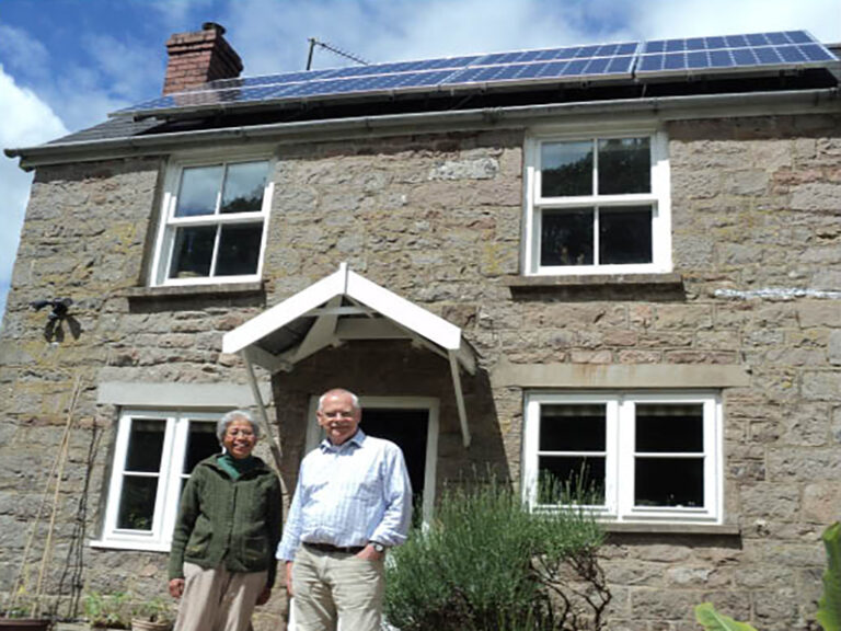 Mr Castle outside of his home with Solar PV on his roof